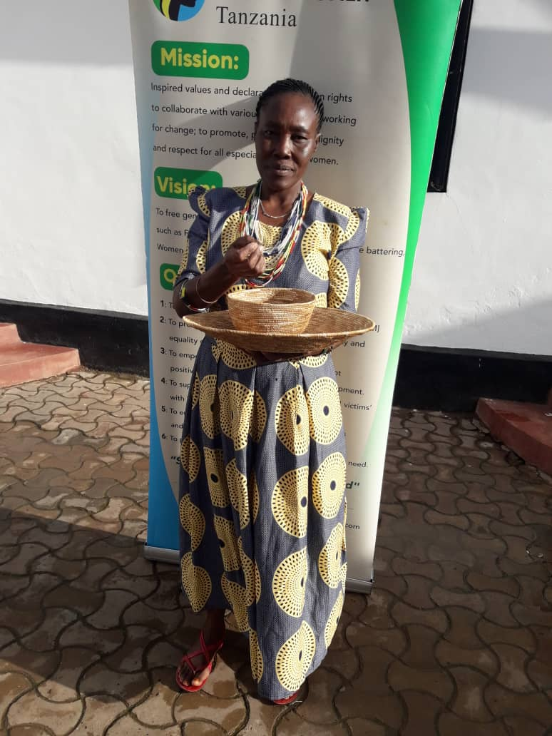 Mohabe Marwa is shown with her former tools used for cutting